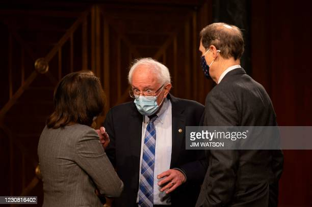 Senator Bernie Sanders , I-VT, speaks with US Senator Maria Canrtwell , D-WA, and US Senator Ron Wyden , D-OR, ahead of a hearing to examine the...