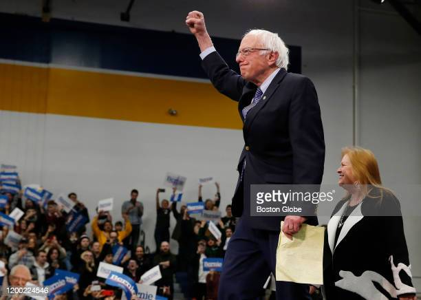 Senator Bernie Sanders pumps his fist as he takes the stage at his Primary Night Rally in Manchester NH on Feb 11 2020 Bernie Sanders claimed victory...