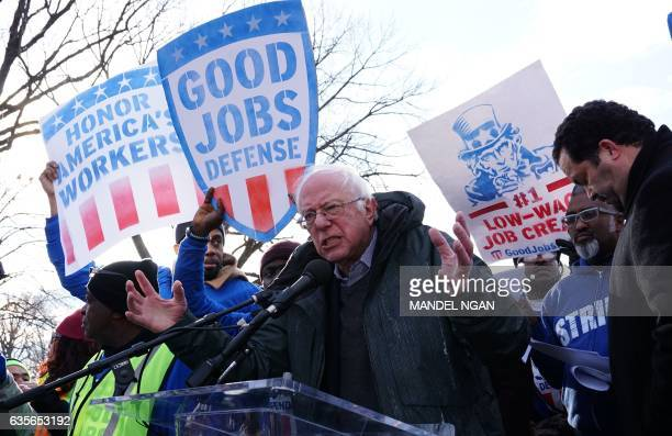 US Senator Bernie Sanders speaks to labor activists as they demonstrate on February 16 after Andrew Puzder withdrew from his nomination as US Labor...