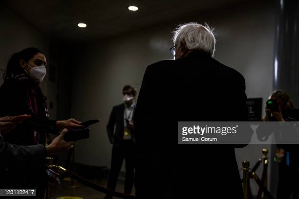 Senator Bernie Sanders talks to reporters in the Senate subway on his way to the fourth day of the Senates second impeachment trial of former...