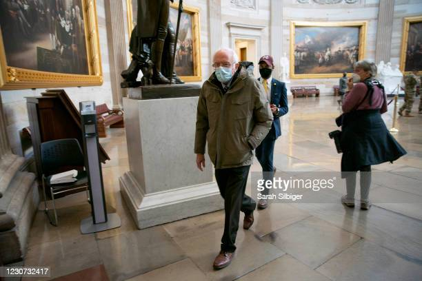 Senator Bernie Sanders walks though the U.S. Capitol rotunda on January 22, 2021 in Washington, DC. The Senate voted to confirm incoming Secretary Of...