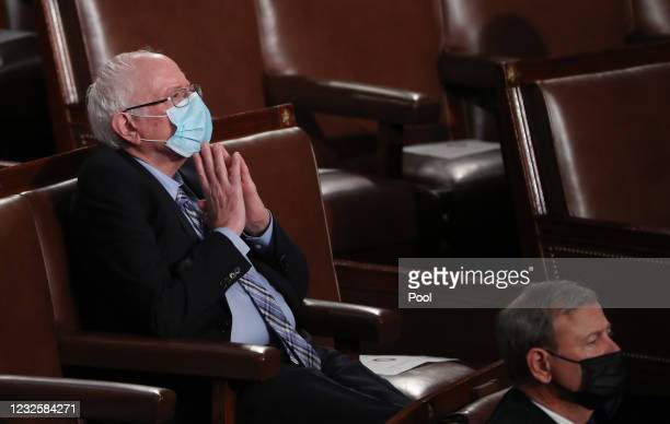Senator Bernie Sanders watches as U.S. President Joe Biden addresses a joint session of Congress in the House chamber of the U.S. Capitol on April...