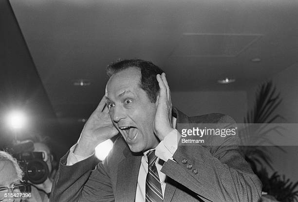 Senator Bill Bradley clowns for the press as he leaves a meeting with state and local Democratic Party officials at the Newark International Airport...