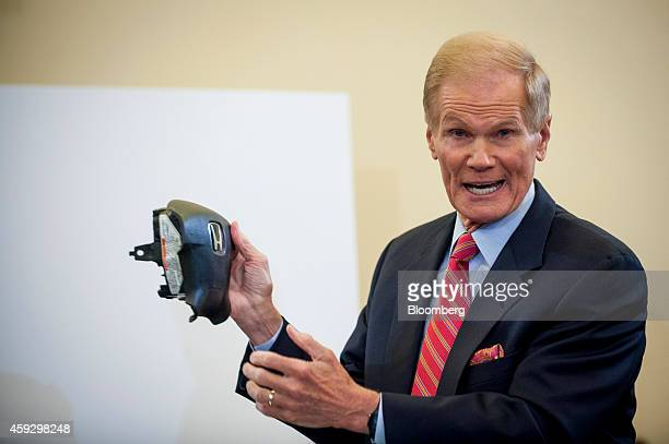 US Senator Bill Nelson a Democrat from Florida displays parts of a Honda Motor Corp airbag system made by Takata Corp at a Senate Committee on...