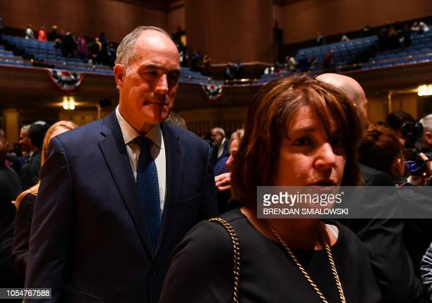 Senator Bob Casey Jr looks on after a vigil to remember the victims of the shooting at the Tree of Life synagogue the day before at the Allegheny...
