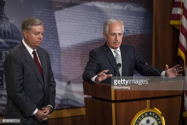 Senator Bob Corker a Republican from Tennessee and chairman of the Senate Foreign Relations Committee right speaks as Senator Lindsey Graham a...
