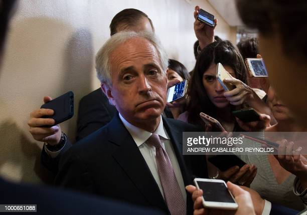 TOPSHOT Senator Bob Corker is surrounded by reporters as they ask him questions regarding the TrumpPutin meeting on July 17 2018 on Capitol Hill in...