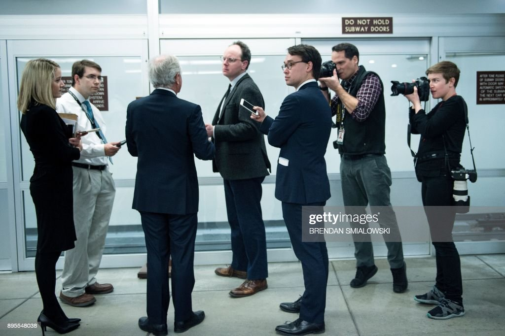 TOPSHOT - Senator Bob Corker (R-TN) speaks to reporters as lawmakers continue to work for tax reform legislation on Capitol Hill December 19, 2017 in Washington, DC. / AFP PHOTO / Brendan Smialowski