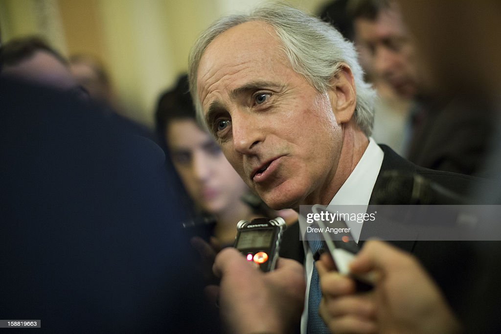Senator Bob Corker (R-TN) talks with reporters outside of the Senate Chamber on Capitol Hill December 30, 2012 in Washington, DC. The House and Senate are both in session today to deal with the looming 'fiscal cliff.' issue.