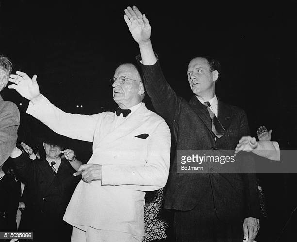 Senator Burton K. Wheeler and Charles Lindbergh pledge allegiance to the American flag at an America First Committee rally at Madison Square Garden...