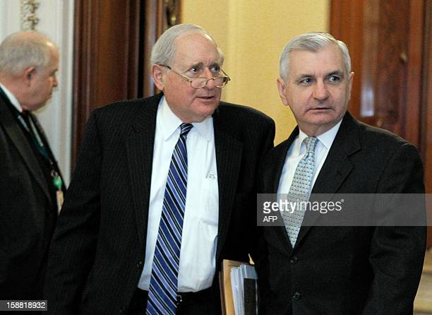 US Senator Carl LevinDMI and Sen Jack ReedDRIleave the Senate chamber to caucus in the US Capitol on December 30 2012 in Washington DC Last minute...