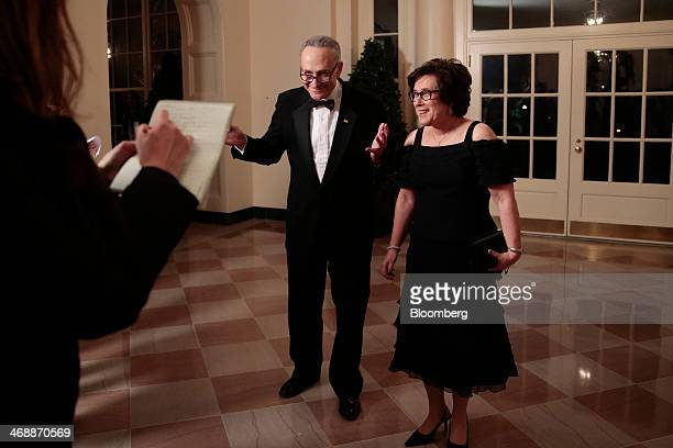 Senator Charles Schumer a Democrat from New York left and his wife Iris Weinshall arrive at a state dinner hosted by US President Barack Obama and US...