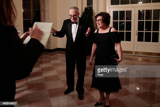 Senator Charles Schumer a Democrat from New York left and Iris Weinshall arrive to a state dinner hosted by US President Barack Obama and US First...