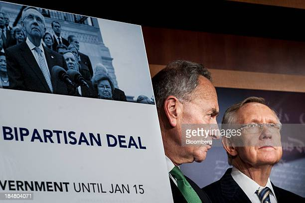 Senator Charles Schumer a Democrat from New York left and Senate Majority Leader Harry Reid a Democrat from Nevada attend a news conference at the US...