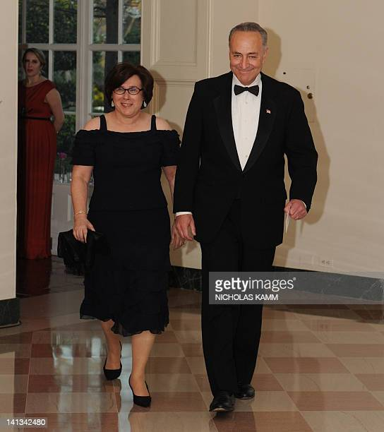 US Senator Charles Schumer DNY and guest Iris Weinshall arrive for the State Dinner in honor of British Prime Minister David Cameron at the White...