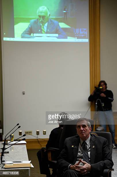 Senator Chris Holbert of Parker and and Senator John Cooke of Greeley watch a testimony is shared from other parts of the state as the Senate...