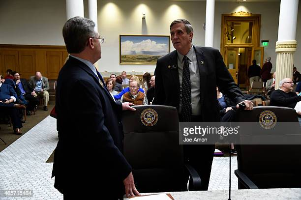Senator Chris Holbert of Parker and Senator John Cooke of Greeley talk before the Senate Judiciary Committee take's up Senate Bill 175 by Republican...