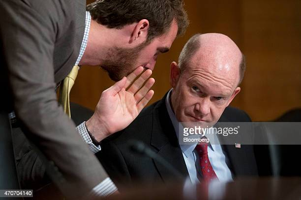 """Senator Christopher """"Chris"""" Coons, a Democrat from Delaware, right, talks to an aid during a Senate Transportation, Housing and Urban Development..."""