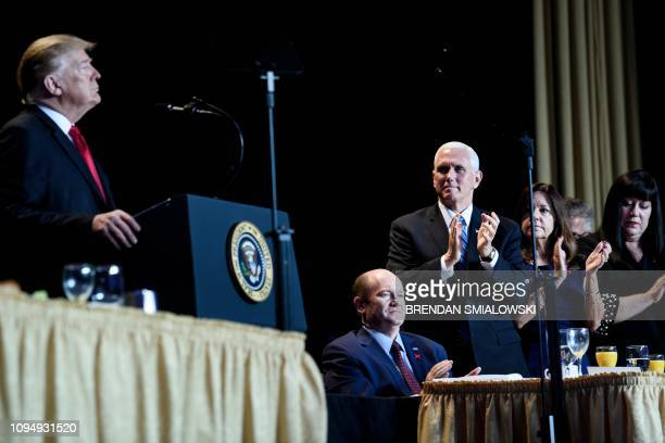 US Senator Christopher Coons US Vice President Mike Pence and others clap for US President Donald Trump during the National Prayer Breakfast on...
