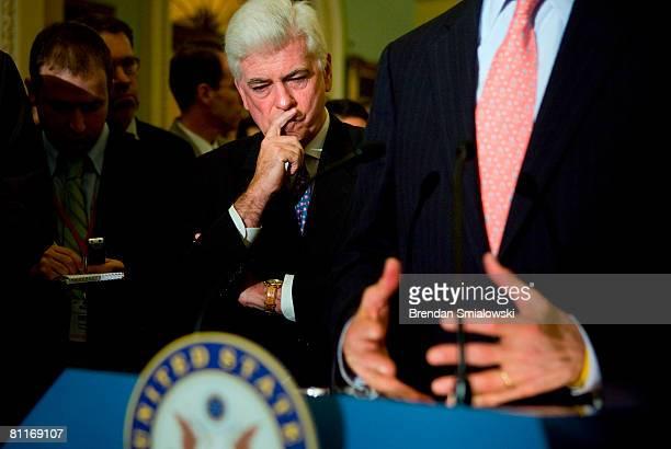 S Senator Christopher Dodd listens to Senator John Kerry speak on Capitol Hill May 20 2008 in Washington DC Senate Majority Leader Harry Reid Senator...