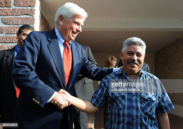 US Senator Christopher J Dood jokes as he shakes hands with Honduran Congress' vicepresident and member of the National Popular Resistance Front...