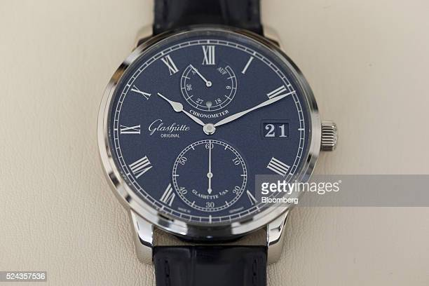 A Senator Chronometer in white gold with blue dial luxury wristwatch sits on display at the Glashuette Original watch factory operated by Swatch...