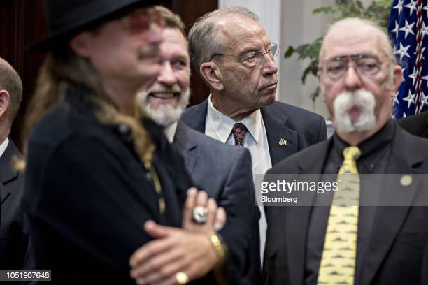 Senator Chuck Grassley a Republican from Iowa and chairman of the Senate Judiciary Committee center attends a signing ceremony for HR 1551 the...