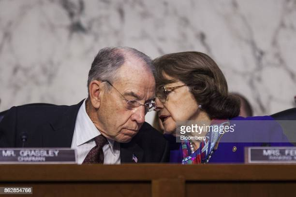 Senator Chuck Grassley a Republican from Iowa and chairman of the Senate Judiciary Committee left speaks with ranking member Senator Dianne Feinstein...