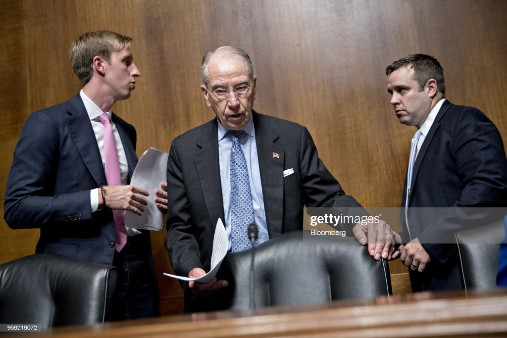 Senator Chuck Grassley, a Republican from Iowa and chairman of the Senate Judiciary Committee, center, arrives to a hearing on Cambridge Analytica and the future of data privacy in Washington, D.C., U.S., on Wednesday, May 16, 2018. Cambridge Analytica is a U.K.-based data broker that improperly gained access to tens of millions of Facebook users' personal data. The firm, which announced its dissolution earlier this month, used the Facebook data in targeted influence campaigns for Donald Trump's 2016 presidential campaign. Photographer: Andrew Harrer/Bloomberg via Getty Images