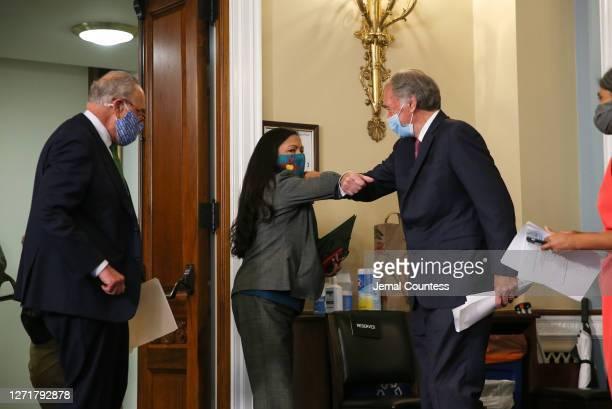 Senator Chuck Schumer and Senator Ed Markey greet Representative Deb Haaland before the start of the Back the Thrive Agenda press conference at the...