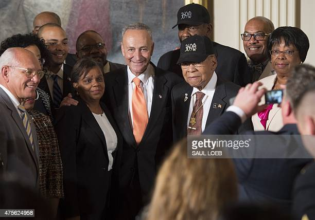 US Senator Chuck Schumer Democrat of New York poses for photos with veterans of the 369th Infantry Regiment nicknamed the 'Harlem Hellfighters'...