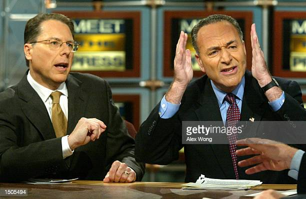 S Senator Chuck Schumer gestures as he debates with National Rifle Association Executive Vice President Wayne LaPierre on 'Meet the Press' during a...