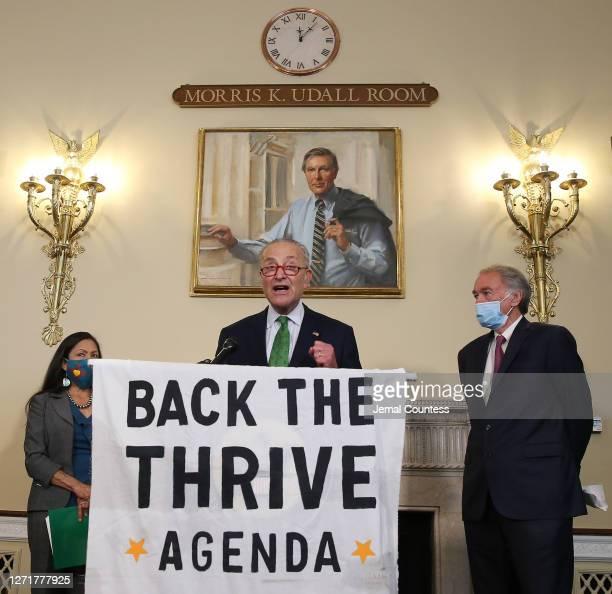 Senator Chuck Schumer speaks along side Representative Deb Haaland and Senator Ed Markey at the Back the Thrive Agenda press conference at the...