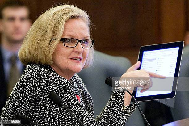 Senator Claire McCaskill a Democrat from Missouri displays an Apple Inc iPad during a Senate Commerce Committee panel hearing on mobile privacy in...