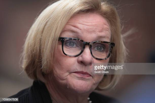 Senator Claire McCaskill fields questions from reporters following a campaign stop at Shakespeare's Pizza on November 2 2018 in Columbia Missouri...