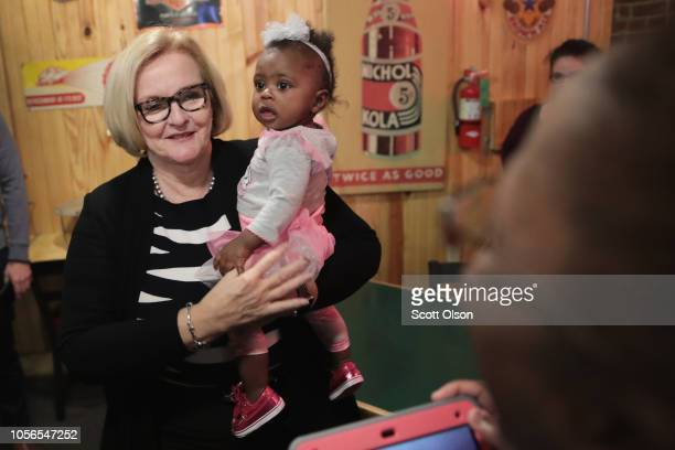 Senator Claire McCaskill greets supporters during a campaign stop at Shakespeare's Pizza on November 2 2018 in Columbia Missouri McCaskill is in a...