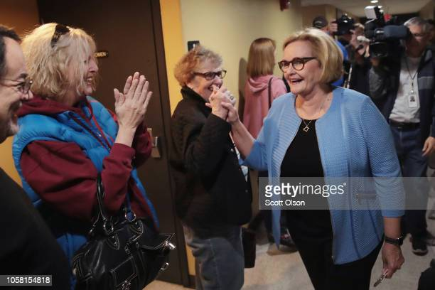 Senator Claire McCaskill is greeted by people waitng to vote as she leaves the polling station after voting on November 6 2018 in Kirkwood Missouri...