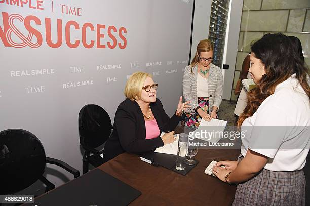 S Senator Claire McCaskill signs her book for an attendee of the TIME And Real Simple's Annual Women Success Event at Park Hyatt Hotel New York on...