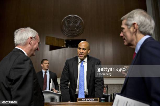 Senator Cory Booker a Democrat from New Jersey center speaks with Jeffrey Rosen deputy transportation secretary nominee for US President Donald Trump...