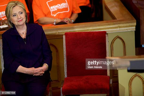 Senator Cory Booker points towards Democratic Presidential candidate former Secretary of State Hillary Clinton at a Breaking Down Barriers Town Hall...