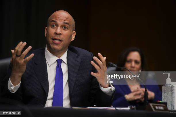 Senator Cory Booker speaks as Sen. Kamala Harris looks on during a Senate Judiciary Committee hearing to examine issues involving race and policing...