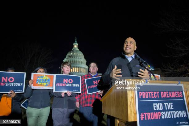 Senator Cory Booker speaks at a rally outside the US Capital on January 19 2018 in Washington DC A continuing resolution to fund the government has...