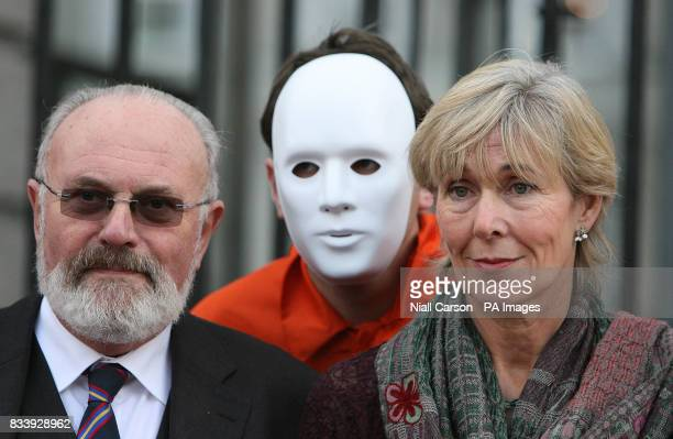 Senator David Norris and Labour TD Liz McManus join Members of Amnesty international as they carry a blown up card bearing the slogan 'Torture...