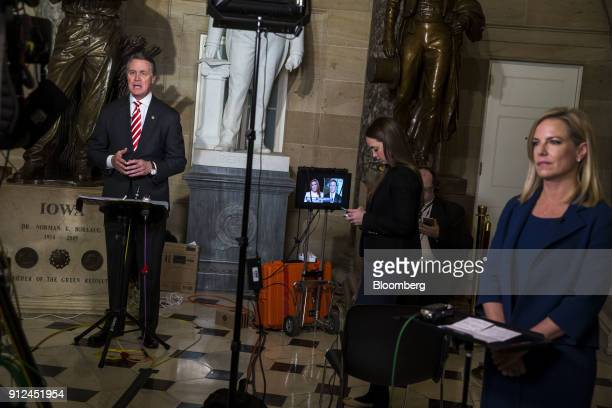 Senator David Perdue a Republican from Georgia left and Kirstjen Nielsen secretary of Homeland Security speak to members of the media following a...