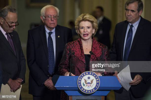Senator Debbie Stabenow a Democrat from Michigan speaks while Senate Minority Leader Chuck Schumer a Democrat from New York left Senator Bernie...
