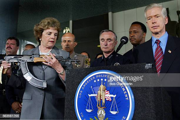 Senator Diane Feinstein holds AK–47 assault rifle during appearance with Governor Gray Davis and police chiefs from around the state to urge Congress...