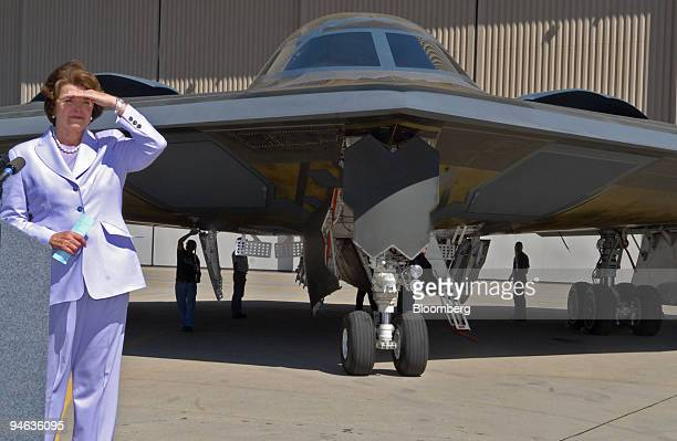 S Senator Dianne Feinstein a Democrat from California shields her eyes from the sun during a news conference at the Northrup Grumman Corp facility in...