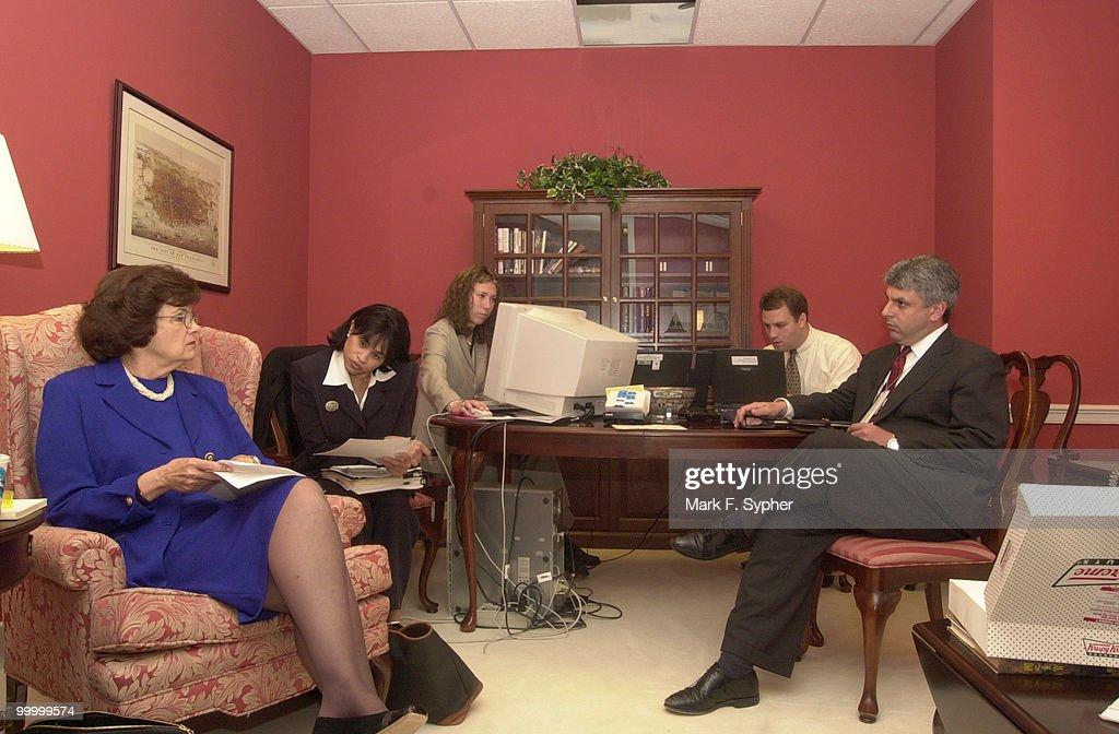 Senator Dianne Feinstein (D-CA) confers with staffers (from left) LaVita Strickland (Legal Assistant for Immigration), Tamar Magarils, Mark Kadesh (Cheif of Staff) and Steve Cash (Legal Assistant), in her make-shift office in the Capitol's basement (SC10).