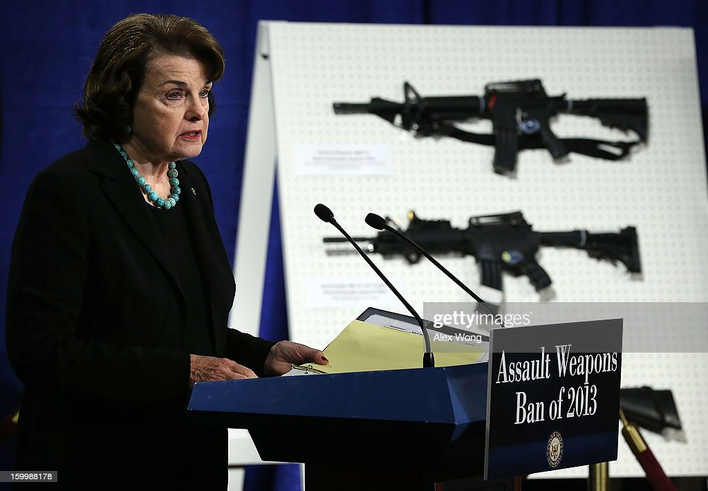 U.S. Senator Dianne Feinstein (D-CA) speaks next to a display of assault weapons during a news conference January 24, 2013 on Capitol Hill in Washington, DC. Feinstein announced that she will introduce a bill to ban assault weapons and high-capacity magazines capable of holding more than 10 rounds to help to stop gun violence