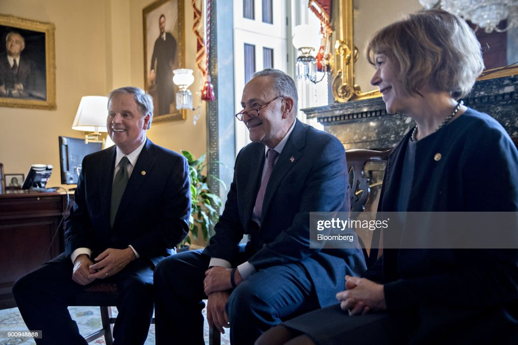 Senator Doug Jones, a Democrat from Alabama, from left, Senate Minority Leader Chuck Schumer, a Democrat from New York, and Senator Tina Smith, a Democrat from Minnesota, sit during a meeting at the U.S. Capitol in Washington, D.C, U.S., on Wednesday, Jan. 3, 2018. Two new Democrats arrived in the U.S. Senate today, reducing the Republican majority to one vote and lifting the number of women in the chamber to a record level. Photographer: Andrew Harrer/Bloomberg via Getty Images